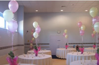 Pink floating helium balloons and balloon weights