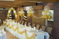 Wedding balloon clouds behind head table